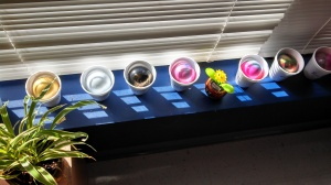 Paint-swirled glass balls drying in the sun